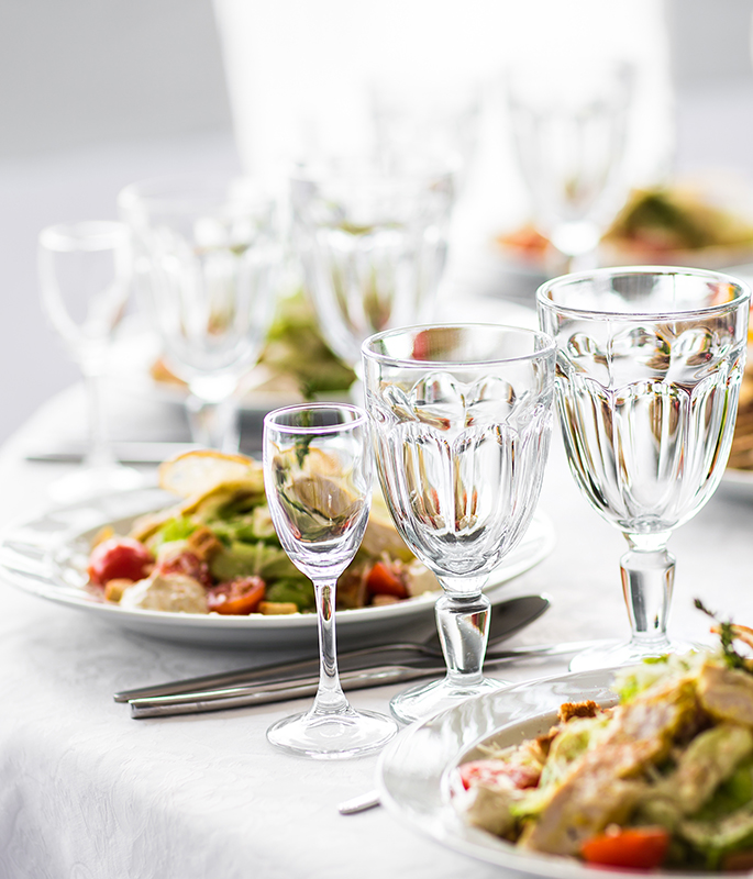 Empty glasses set in restaurant. Banquet table set